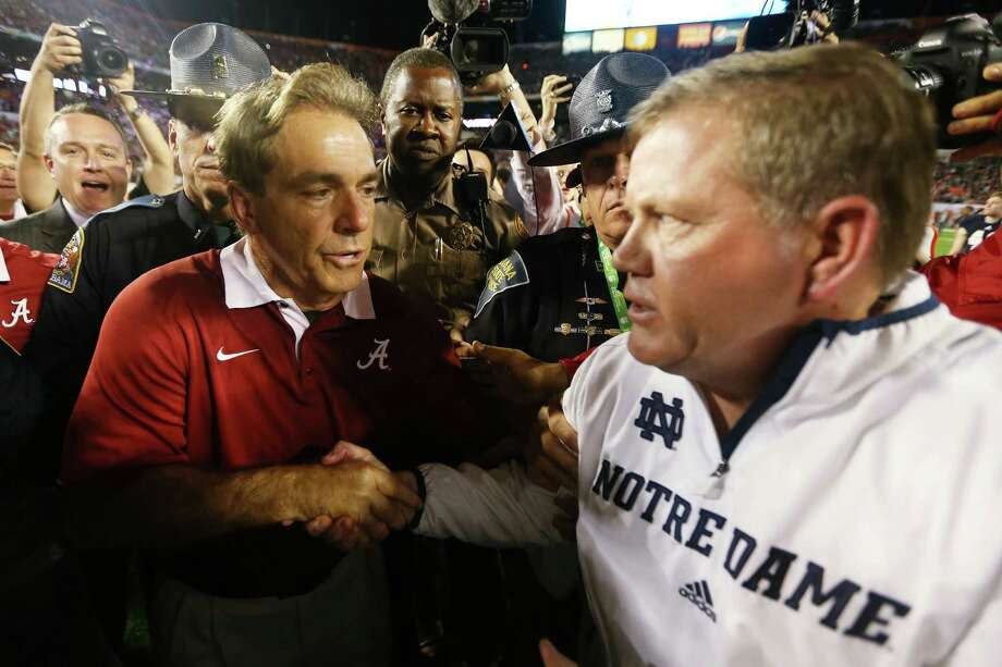 Head coach Nick Saban (L) of the Alabama Crimson Tide and head coach Jim Kelly of the Notre Dame Fighting Irish shake hands after the 2013 Discover BCS National Championship game at Sun Life Stadium on January 7, 2013 in Miami Gardens, Florida. Alabama won the game by a score of 42-14. Photo: Getty Images