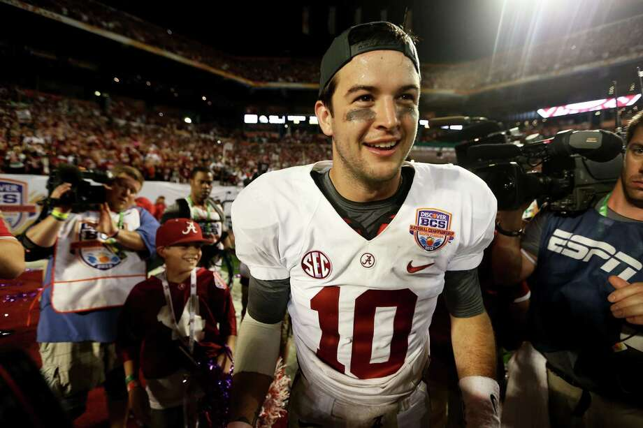 AJ McCarron #10 of the Alabama Crimson Tide celebrates after defeating the Notre Dame Fighting Irish by a score of 42-14 to win the 2013 Discover BCS National Championship game at Sun Life Stadium on January 7, 2013 in Miami Gardens, Florida. Photo: Getty Images
