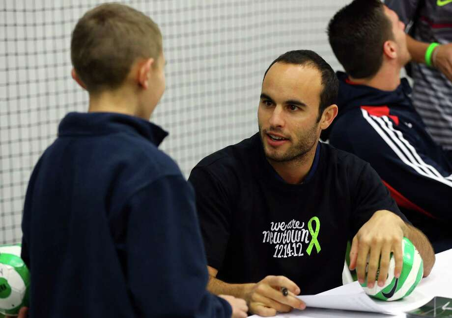 Landon Donovan of the Los Angeles Galaxy signs autographs during Soccer Night in Newtown on Monday in the grieving Connecticut town. Photo: Mike Stobe, Stringer / 2012 Getty Images