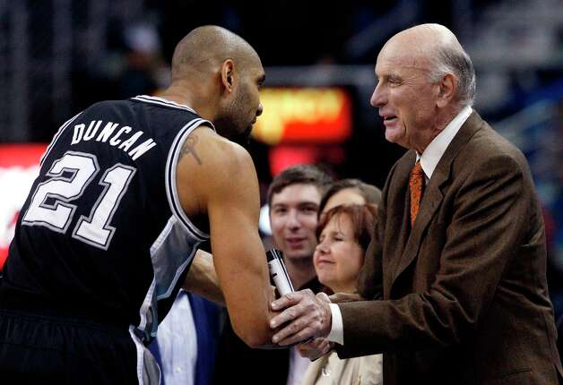 Spurs power forward Tim Duncan (21) shakes hands with former NBA player Bob Pettit before the start of Monday's game in New Orleans. Photo: Bill Haber, Associated Press / FR170136 AP
