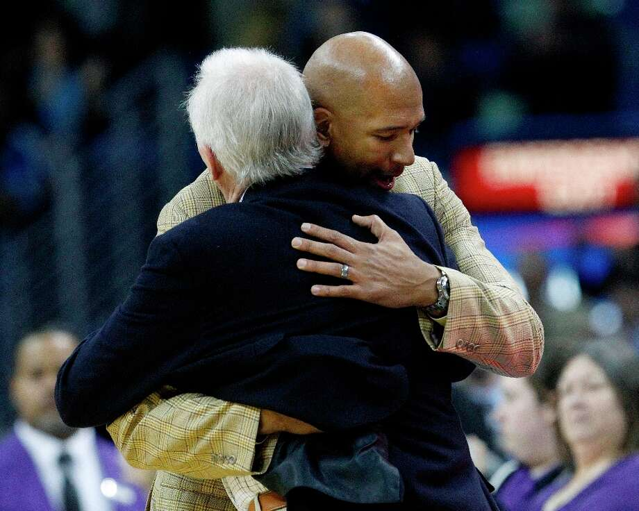 New Orleans Hornets coach Monty Williams hugs Spurs coach Gregg Popovich after the game  in New Orleans, Monday, Jan. 7, 2013. The Hornets defeated the Spurs 95-88. Photo: Bill Haber, Associated Press / FR170136 AP