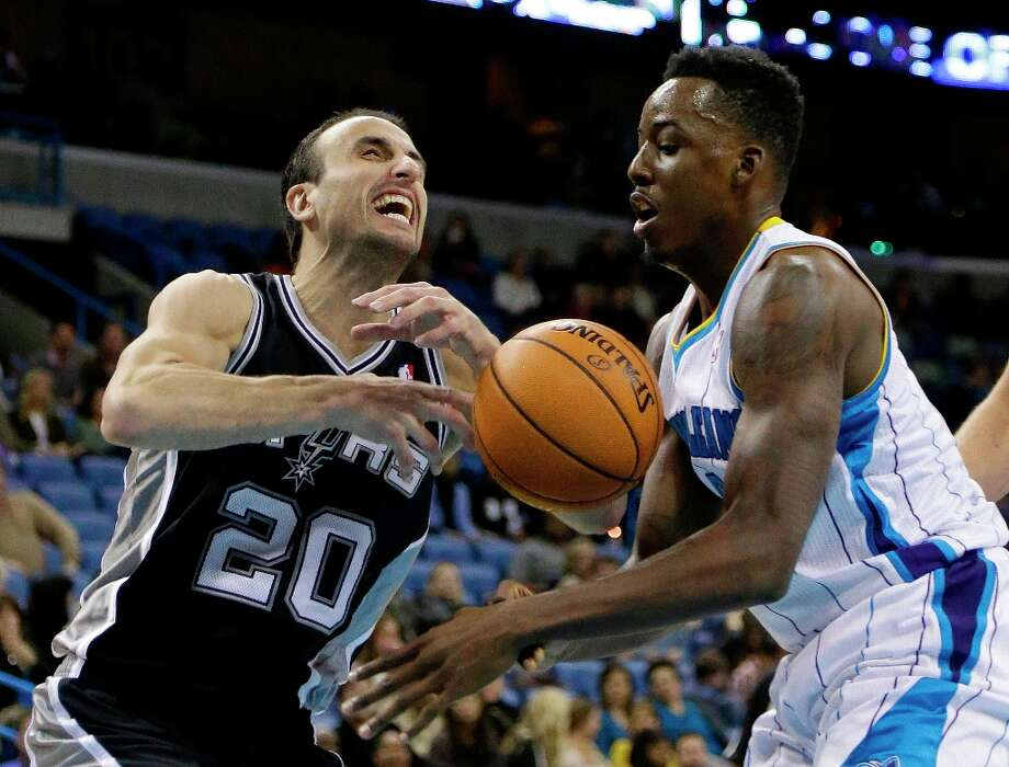 Spurs guard Manu Ginobili (20) has the ball knocked away by New Orleans Hornets forward Al-Farouq Aminu (0) in the second half  in New Orleans, Monday, Jan. 7, 2013. The Hornets defeated the Spurs 95-88. Photo: Bill Haber, Associated Press / FR170136 AP