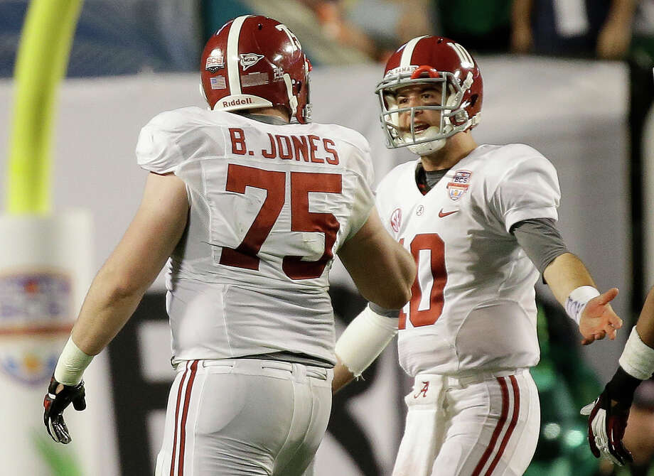Alabama's AJ McCarron (10) and Barrett Jones argue during the second half of the BCS National Championship college football game against Notre Dame Monday, Jan. 7, 2013, in Miami. (AP Photo/David J. Phillip) Photo: David J. Phillip, Associated Press / AP