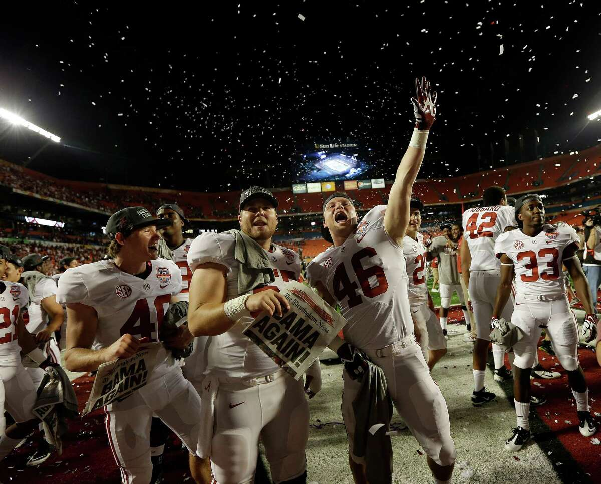 Alabama players celebrate after the BCS National Championship college football game against Notre Dame Monday, Jan. 7, 2013, in Miami. Alabama won 42-14. (AP Photo/David J. Phillip)