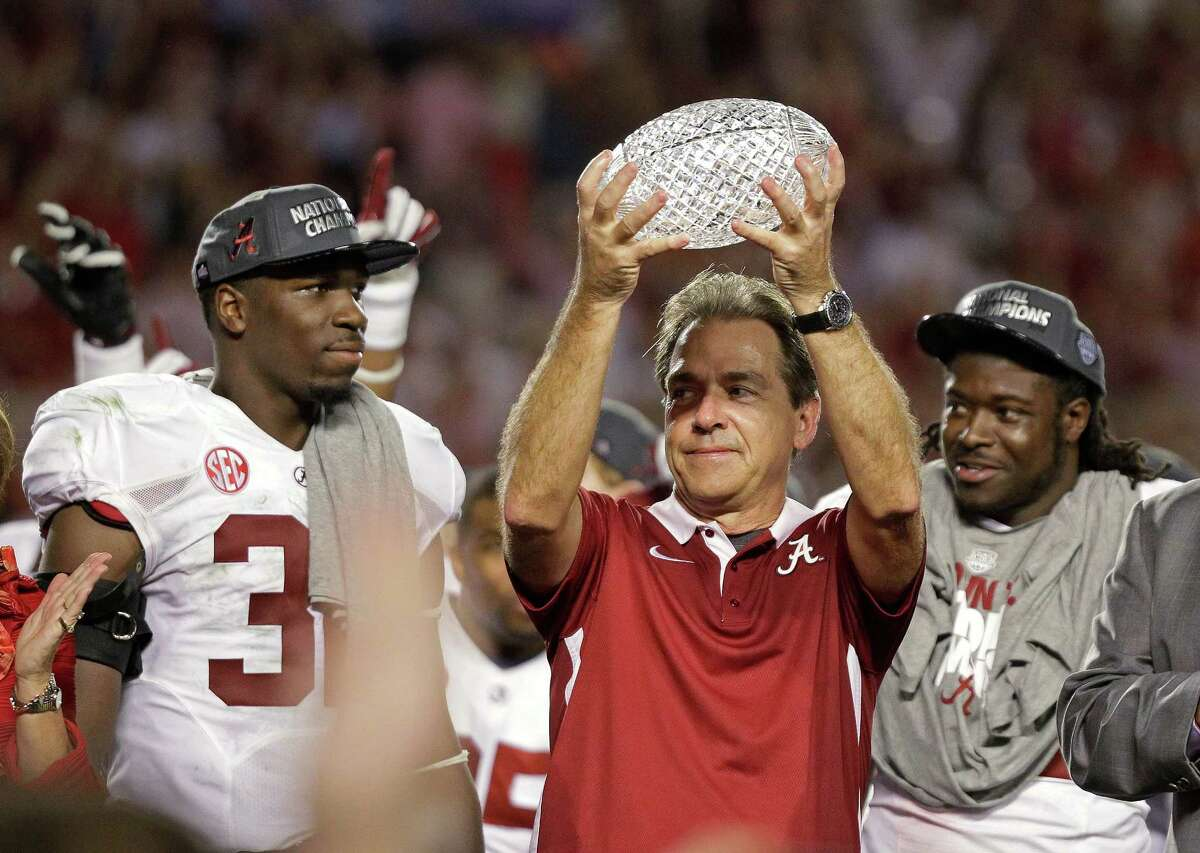 Alabama head coach Nick Saban holds up the championship trophy after the BCS National Championship college football game against Notre Dame Monday, Jan. 7, 2013, in Miami. Alabama won 42-14. (AP Photo/Chris O'Meara)