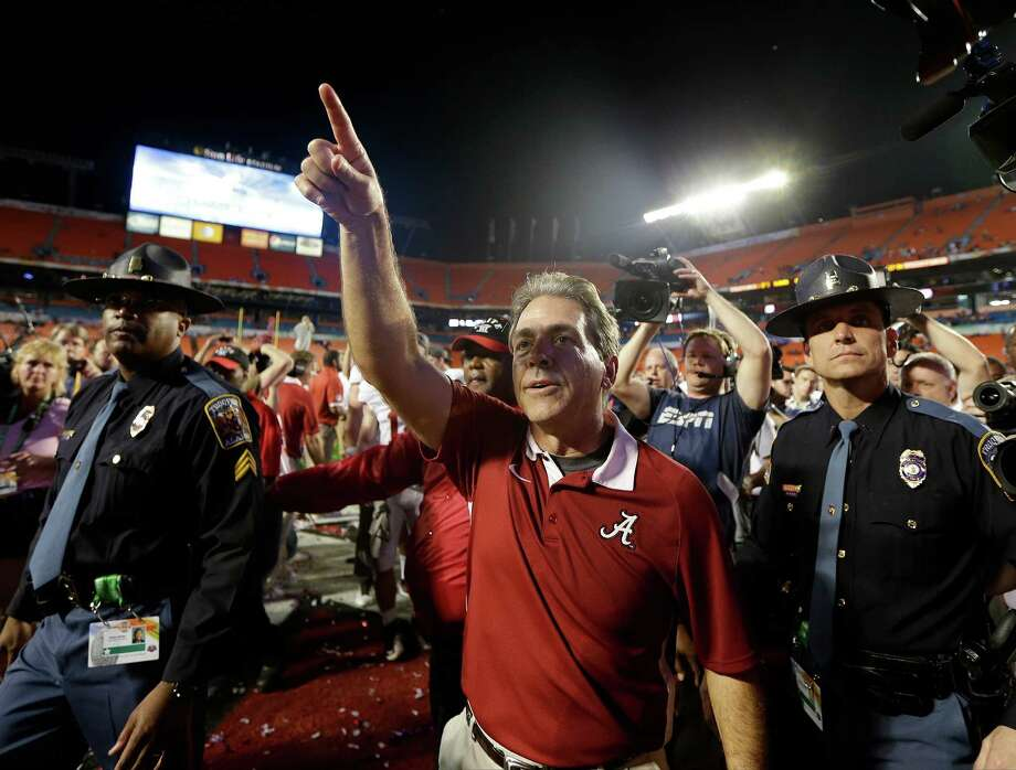 Alabama head coach Nick Saban acknowledges the fans after the BCS National Championship college football game against Notre Dame Monday, Jan. 7, 2013, in Miami. Alabama won 42-14. (AP Photo/David J. Phillip) Photo: David J. Phillip, Associated Press / AP