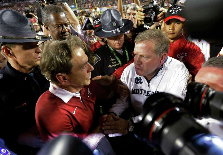 Alabama head coach Nick Saban shakes hands with Notre Dame head coach Brian Kelly after the BCS National Championship college football game Monday, Jan. 7, 2013, in Miami. Alabama won 42-14. (AP Photo/David J. Phillip) Photo: David J. Phillip, Associated Press / AP