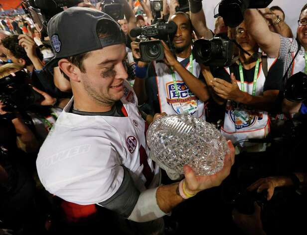 Alabama's AJ McCarron holds The Coaches Trophy after the BCS National Championship college football game against Notre Dame Monday, Jan. 7, 2013, in Miami. Alabama won 42-14. (AP Photo/John Bazemore) Photo: John Bazemore, Associated Press / AP
