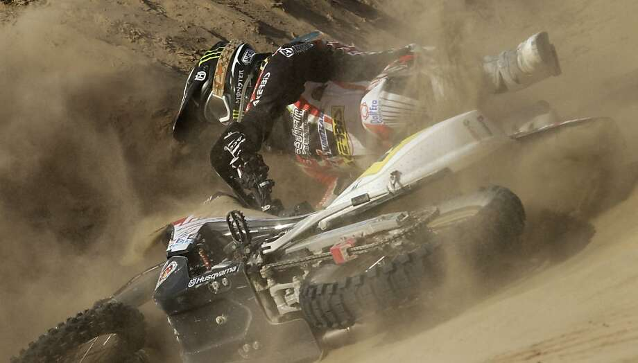 Husqvarna rider Alessandro Botturi of Italy, falls from his motorcycle during the 3nd stage of the 2013 Dakar Rally from Pisco to Nazca, Peru, Monday, Jan. 7, 2013. The race finishes in Santiago, Chile, on Jan. 20. Photo: Victor R. Caivano, Associated Press