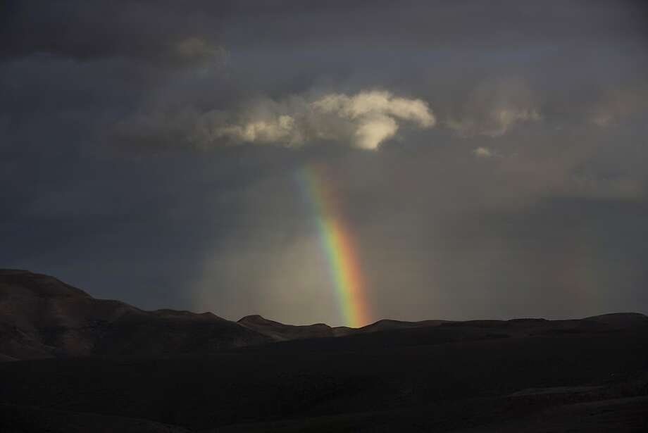 A rainbow is seen in the West Bank Judean desert on January 7, 2013. A stormy weather, including high winds and heavy rainfall, lashed Israel and the Palestinian territories, downing powerlines and trees and causing several injuries. Photo: Menahem Kahana, AFP/Getty Images