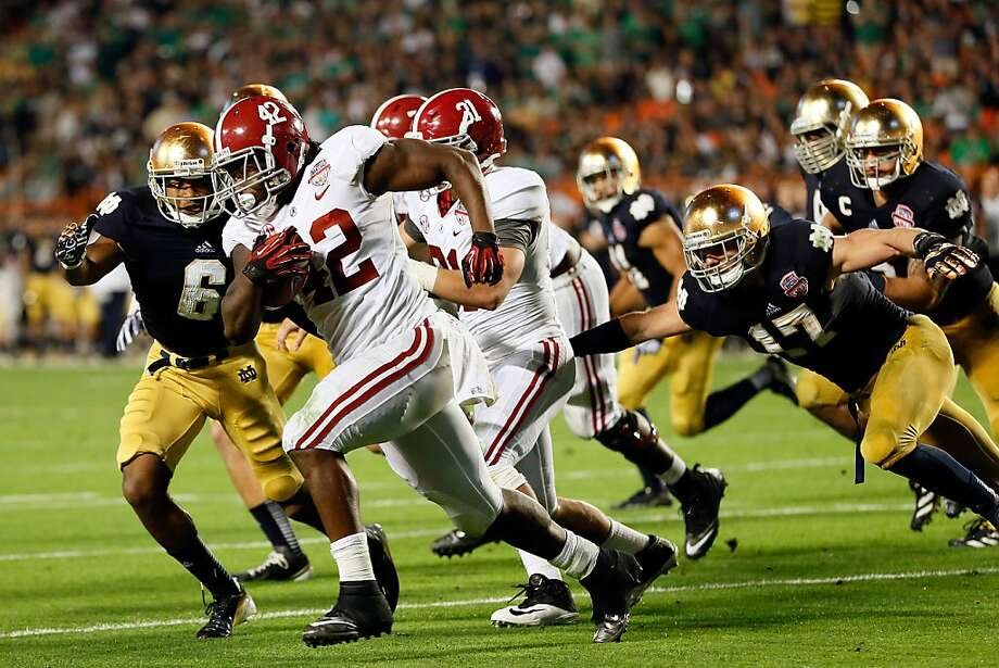MIAMI GARDENS, FL - JANUARY 07:  Eddie Lacy #42 of the Alabama Crimson Tide runs with the ball against the Notre Dame Fighting Irish during the 2013 Discover BCS National Championship game at Sun Life Stadium on January 7, 2013 in Miami Gardens, Florida.  (Photo by Kevin C. Cox/Getty Images) Photo: Kevin C. Cox, Getty Images