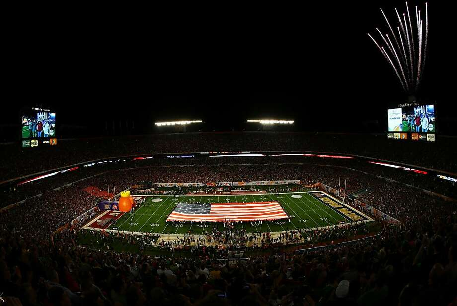 MIAMI GARDENS, FL - JANUARY 07:  A giant American Flag is displayed as fireworks go off prior to the start of the 2013 Discover BCS National Championship game between the Alabama Crimson Tide and the Notre Dame Fighting Irish at Sun Life Stadium on January 7, 2013 in Miami Gardens, Florida.  (Photo by Michael Heiman/Getty Images) Photo: Michael Heiman, Getty Images