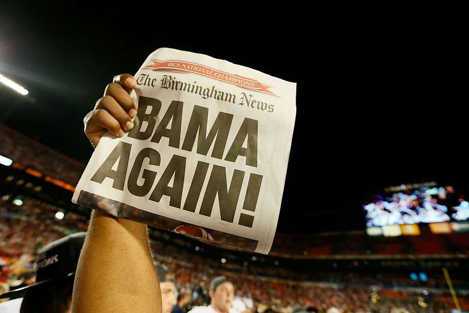 "MIAMI GARDENS, FL - JANUARY 07:  A member of the Alabama Crimson Tide holds up a newpaper front page with a headline reading ""Bama Again!"" after they defeated the Notre Dame Fighting Irish by a score of 42-14 to win the 2013 Discover BCS National Championship game at Sun Life Stadium on January 7, 2013 in Miami Gardens, Florida.  (Photo by Kevin C. Cox/Getty Images) Photo: Kevin C. Cox, Getty Images"