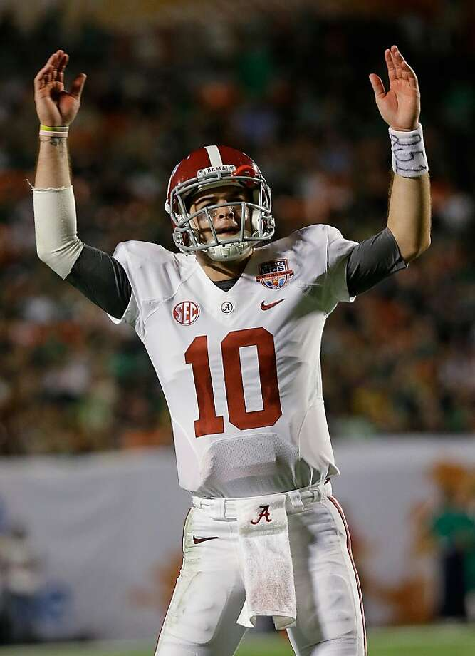 Alabama quarterback AJ McCarron celebrates during the second half of the BCS National Championship college football game against Notre Dame Monday, Jan. 7, 2013, in Miami. (AP Photo/David J. Phillip) Photo: David J. Phillip, Associated Press