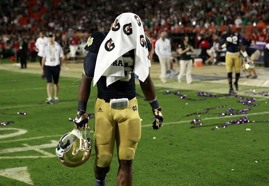 Notre Dame running back Theo Riddick leaves the field after a 42-14 loss against Alabama in the BCS National Championship game at Sun Life Stadium on Monday, January 7, 2013, in Miami Gardens, Florida. (Nuccio DiNuzzo/Chicago Tribune/MCT) Photo: Nuccio DiNuzzo, McClatchy-Tribune News Service