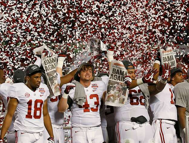 Alabama players celebrate after the BCS National Championship college football game against Notre Dame Monday, Jan. 7, 2013, in Miami. Alabama won 42-14. (AP Photo/Wilfredo Lee) Photo: Wilfredo Lee, Associated Press