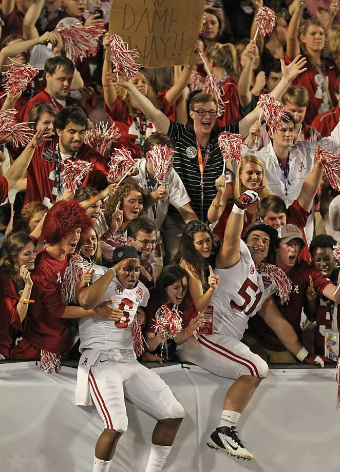 Alabama fans celebrate with HaHa Clinton-Dix (6) and Wilson Love (51) after defeating Notre Dame in the BCS National Championship game at Sun Life Stadium on Monday, January 7, 2013, in Miami Gardens, Florida. (Al Diaz/Miami Herald/MCT) Photo: Al Diaz, McClatchy-Tribune News Service