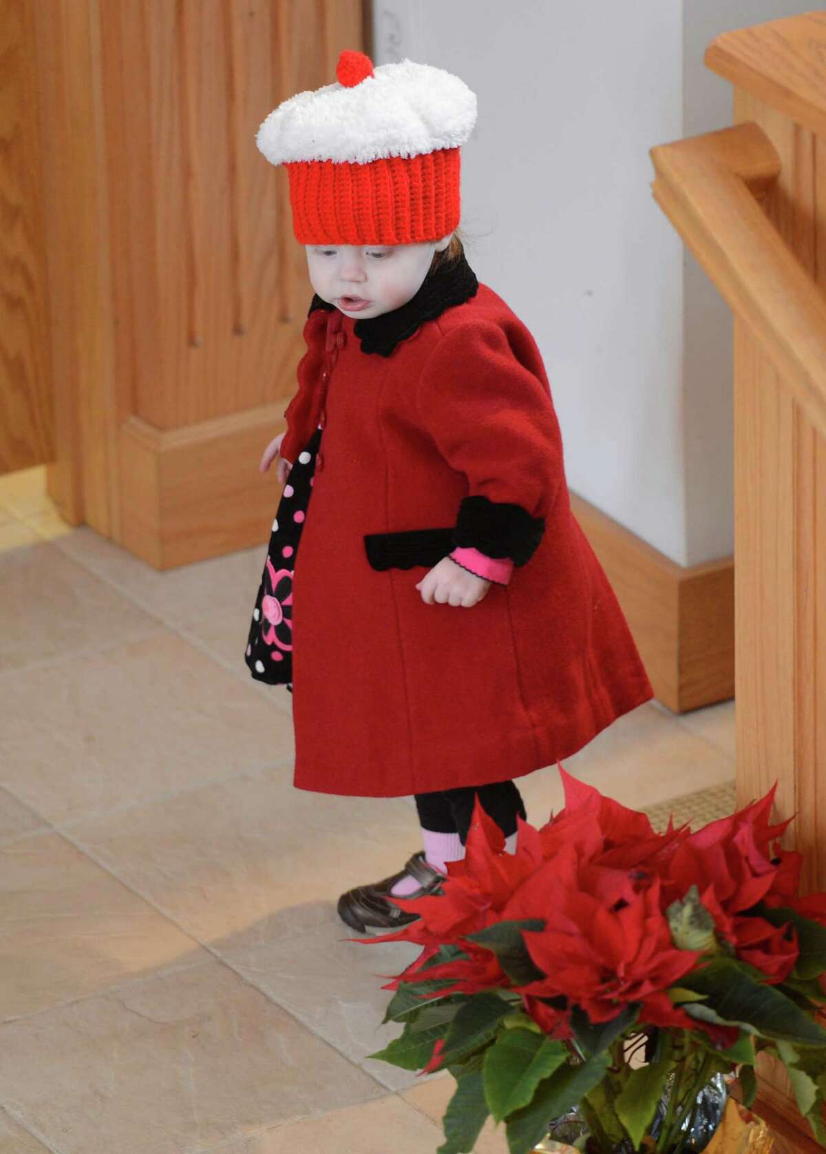 Anysia Baker,who will be 2 years old in February, enjoys the colors of the season before the Christmas Day celebration at the Nativity of the Mother of God Russian Orthodox Church Monday morning, Jan. 7, 2013, in Colonie, N.Y.The Russian Orthodox Church uses the