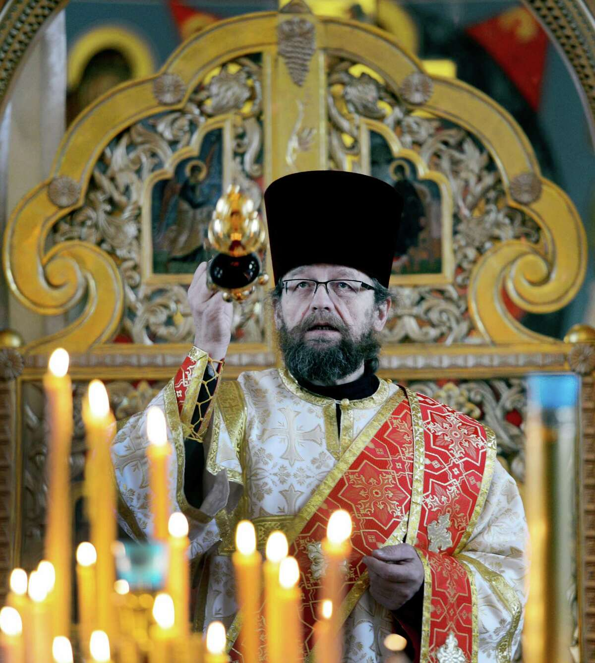 Deacon Michael Soloviev burns incense before the Christmas Day celebration at the Nativity of the Mother of God Russian Orthodox Church Monday morning, Jan. 7, 2013, in Colonie, N.Y. The Russian Orthodox Church uses the