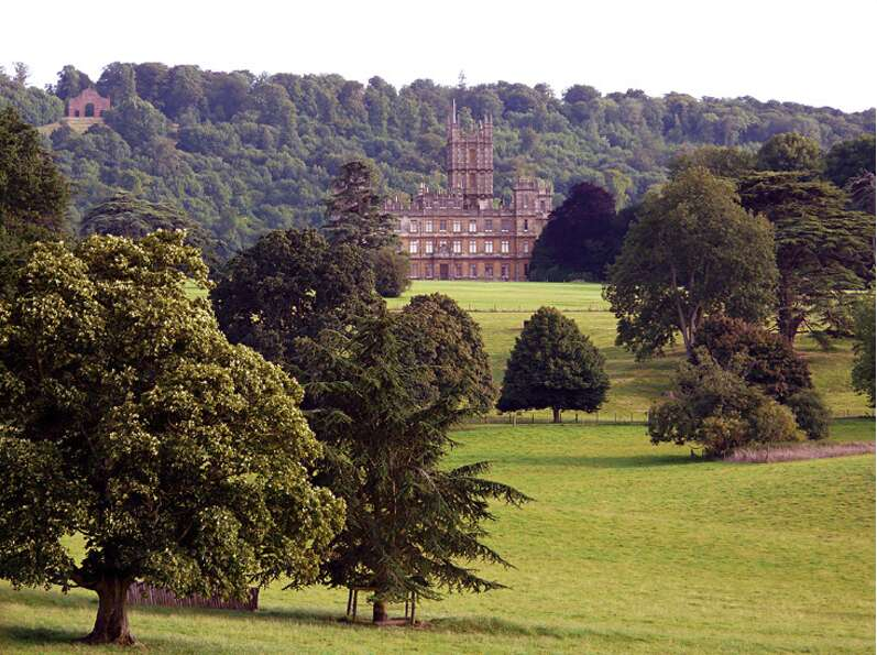 The familiar exterior of Highclere Castle, as Downton Abbey, inevitably brings to mind the opening b