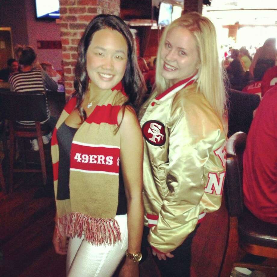 Laura Hayes sent this photo, with a friend in an equally sweet and retro-looking 49ers knit scarf. (That can be a future contest.) You could walk into a bar with a million dollars in diamonds around your neck, but everyone would still be staring at the girl in the shiny 49ers jacket.