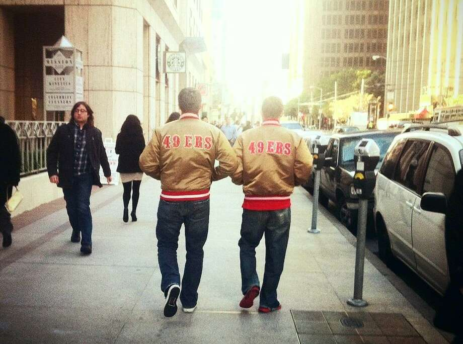 The jacket looks cool anywhere. The game, a bar, a party. And especially the financial district in San Francisco. Here is a great shot of my boss and I walking to lunch in our gold Jackets on casual Friday. Go Niners! Forever Faithful, Charlie Walker