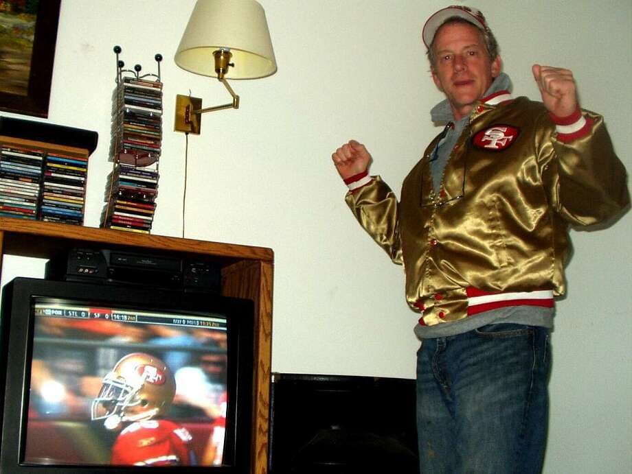 Dirk Snyder loves his satin jacket, bought by his father in the 1980s and inherited after his father passed in 1995. Bonus points for taking the photo with the 49ers/Rams game in the background -- during happier times, when the teams were still tied 0-0 in the second quarter.