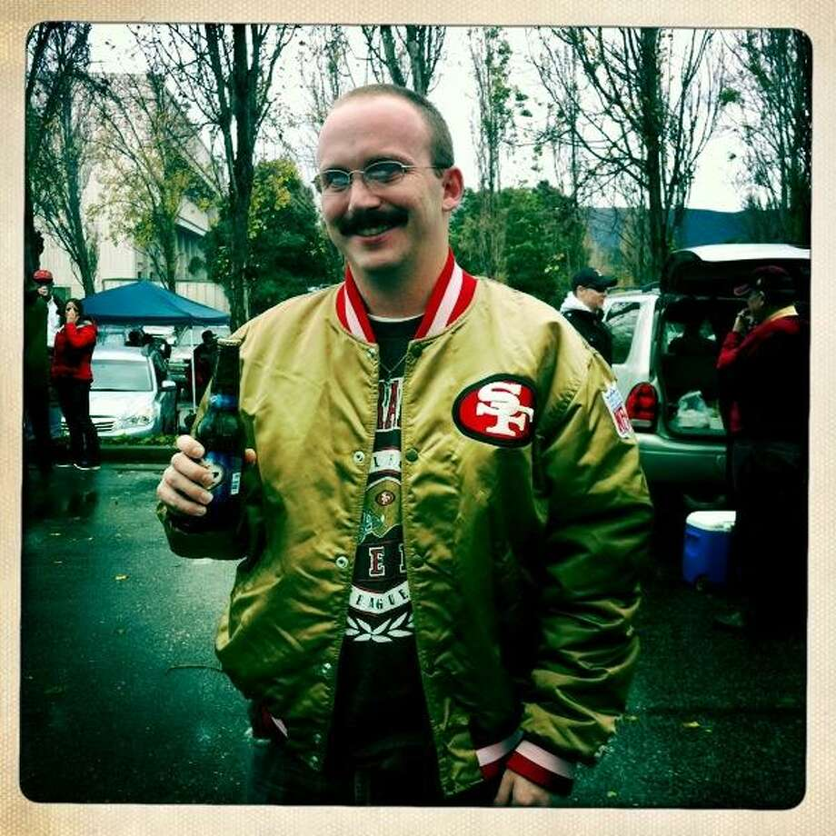 Our second great entry by someone named Charlie Walker. Charlie writes: Here's a pic of me in my gold jacket last November. With the addition of the Mo'vember mustache this picture just as well could have been taken in the late 70's. In Harbaugh We Trust, Charlie Walker - Faithful since 1982.