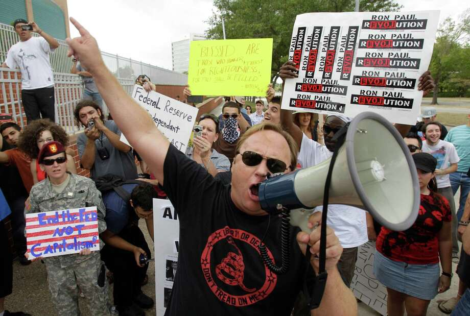 Alex Jones joins protesters in front of the Federal Reserve, Oct. 8, 2011, in Houston, during an  Occupy Houston and Houston Free Thinkers protest. Photo: Melissa Phillip, Houston Chronicle / © 2011 Houston Chronicle