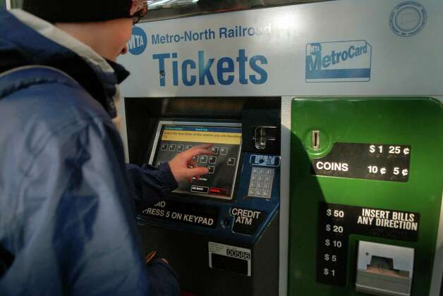 Commuters by tickets at the Stamford ( Conn.) train station on Monday January 7, 2013. Photo: Dru Nadler / Stamford Advocate Freelance