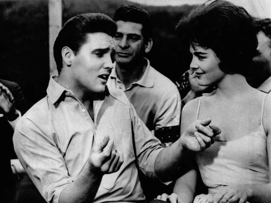 "FILE - In this undated file photo, Elvis Presley, left, appears in a scene from the movie, ""Kid Galahad."" A parent in a Salt Lake City suburb who was upset about Elvis Presley songs in a high-school drama prompted educators to cancel the musical, deeming it too sexual. But the decision was reversed Thursday by school administrators. (AP Photo, File) Photo: HOEP / AP"