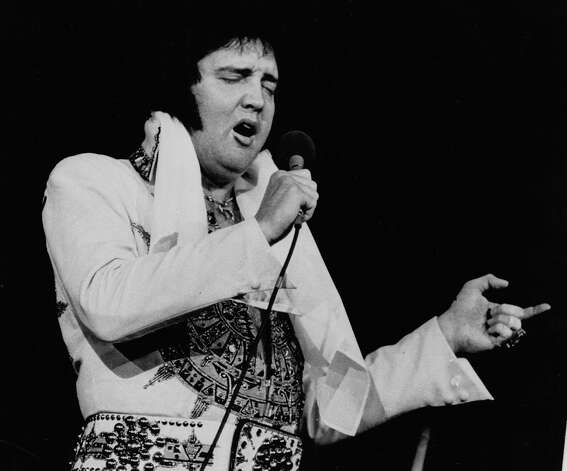 FILE - In this May 23, 1977 file photo, Elvis Presley performs in Providence, R.I., three months before his death. On June 6, 2012, Digital Domain Media Group announced it was creating a hologram Presley for shows, film, TV, and other projects worldwide, including appearances. Permission was granted from Elvis Presley Enterprises. (AP Photo, File) Photo: Uncredited, STF