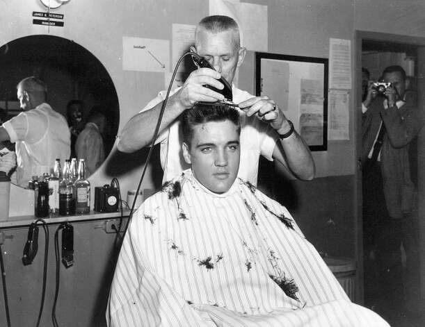 ** FILE ** In this March 1958 file photo, singer Elvis Presley gets his hair cut before entering the Army at Fort Chaffee in Barling, Ark. According the the U.S. Army, Presley entered the service March 24, 1958, at Fort Chaffee Reception Station. (AP Photo/File) / AP2008