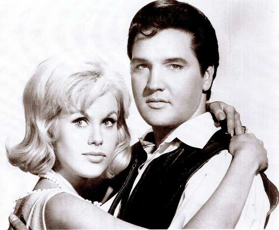 "Suzanna Leigh embraces Elvis Presley in a publicity photo from the 1966 film ""Paradise, Hawaiian Style."" Leigh was one of Presley's many female co-stars and is organizing a gathering of actors, actresses and others who worked on Presley's movies. The gathering is scheduled to be held in Memphis, Tenn. to mark the 30th anniversary of Presley's death. (AP Photo/courtesy Suzanna Leigh) Photo: Anonymous, HO / AP2007"