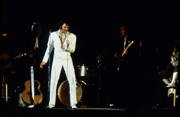 03/01/1970 - singer Elvis Presley performs at the 1970 Houston Livestock Show and Rodeo in the Astrodome. Presley made six appearances over three days at the Houston rodeo. His Saturday evening performance broke all rodeo attendance records with a crowd of 43,614.  Fred Bunch / Houston Post Photo: Fred Bunch, HP Staff / Houston Post