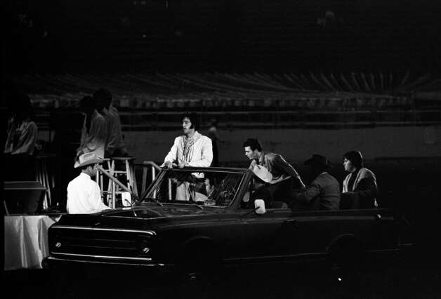 03/01/1970 - singer Elvis Presley enters the Astrodome to perform for the 1970 Houston Livestock Show and Rodeo.. Presley made six appearances over three days at the Houston rodeo. His Saturday evening performance broke all rodeo attendance records with a crowd of 43,614.  Fred Bunch / Houston Post Photo: Fred Bunch, HP Staff / THE HOUSTON CHRONICLE