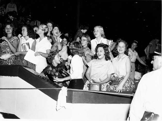 Fans crowded in to see Elvis Presley perform at the Coliseum in Houston, October 13, 1956. Keith Hawkins / Houston Post Photo: Keith Hawkins, HP Staff / THE HOUSTON CHRONICLE
