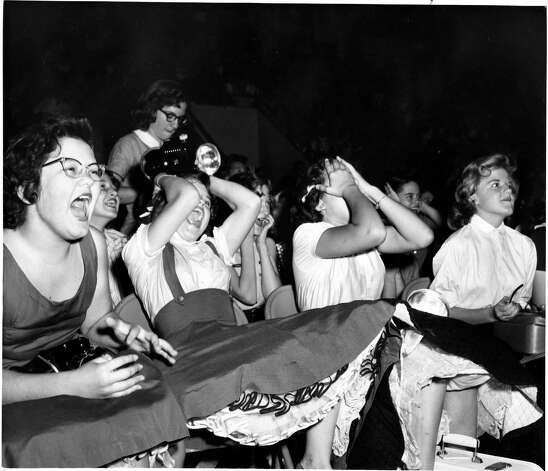 Screaming fans crowded in to see Elvis Presley perform at the Coliseum in Houston, October 13, 1956. Bob Verlin / Houston Post Photo: Bob Verlin, HP Staff / THE HOUSTON CHRONICLE