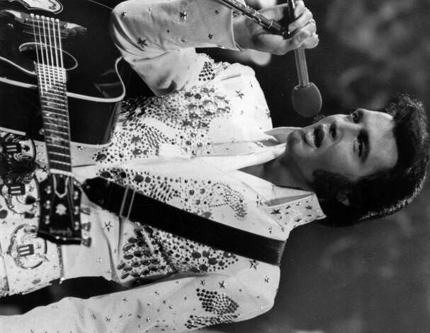 Elvis Presley is shown in concert in the later part of his career.  (AP Photo/NBC-TV) Photo: ANONYMOUS, HO / NBC-TV
