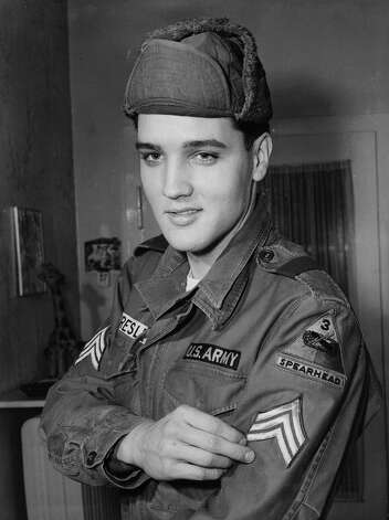 The file photo from January 21, 1960 shows Elvis Presley in a US Army uniform during his military service in Bad Nauheim, Germany. (AP Photo) ---- Unser Archivfoto vom 21. Jan. 1960 zeigt Elvis Presley  in Bad Nauheim, wo er als Soldat der USA-Armee stationiert war. (AP Photo)