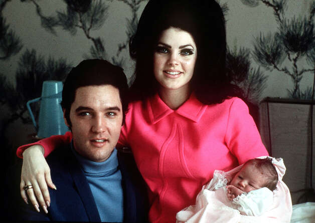 ** FILE ** Elvis Presley poses with wife Priscilla and daughter Lisa Marie, in a room at Baptist hospital in Memphis, Tenn., February 05, 1968. August 16, 2007 marks the 30th anniversary of Presley's death. (AP Photo)