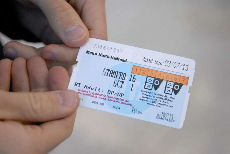 Commuters by tickets at the Stamford train station on Monday, Jan. 7, 2013. Photo: Dru Nadler / Stamford Advocate Freelance