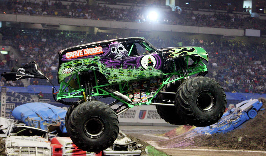 Grave Digger, driven by Chad Tingler, jumps over cars during the Monster Jam Sunday Jan. 11, 2009 at the Alamodome. (PHOTO BY EDWARD A. ORNELAS/eaornelas@express-news.net) Photo: EDWARD A. ORNELAS, SAN ANTONIO EXPRESS-NEWS / eaornelas@express-news.net