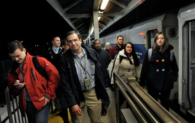 Passengers disembark from the 6:20pm Metro North train in Danbury Monday evening, Jan. 7, 2013. Photo: Carol Kaliff / The News-Times