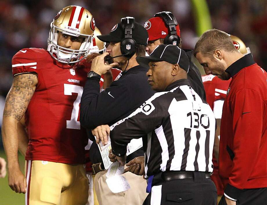 Jim Harbaugh's decision to start Colin Kaepernick (left) over Alex Smith (right) has profound implications on the 49ers' direction. Photo: Carlos Avila Gonzalez, The Chronicle