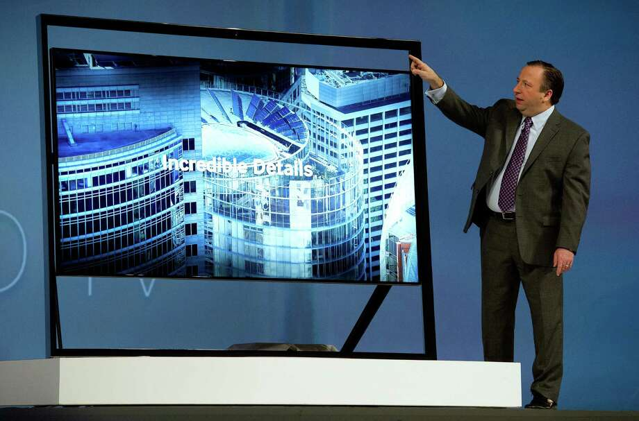 Joe Stinziano, executive vice president of Samsung Electronics America Inc., shows off the new Samsung's Ultra HDTV on Monday. Photo: David Paul Morris, Bloomberg / © 2013 Bloomberg Finance LP