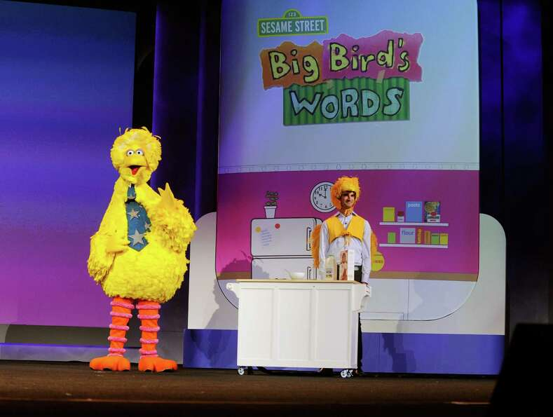 Big Bird of Sesame Street and Birdkateer Dave demonstrate an educational reading tool for children M