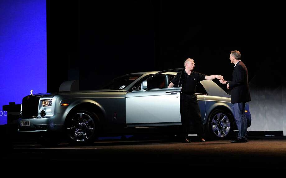 Qualcomm Inc., Chairman and CEO Dr. Paul E. Jacobs (R) receives the keys to an all electric Rolls Royce during a keynote address at The Venetian on Monday. Photo: David Becker, Getty Images / 2013 Getty Images