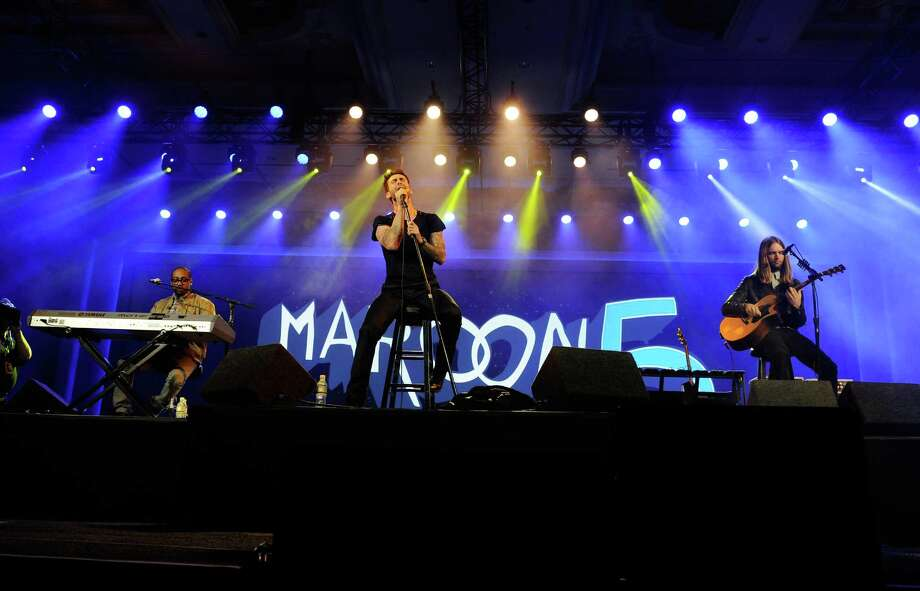 Keyboardist PJ Morton, singer Adam Levine and guitarist James Valentine of Maroon 5 perform at the 2013 International CES at The Venetian on Monday. Photo: David Becker, Getty Images / 2013 Getty Images