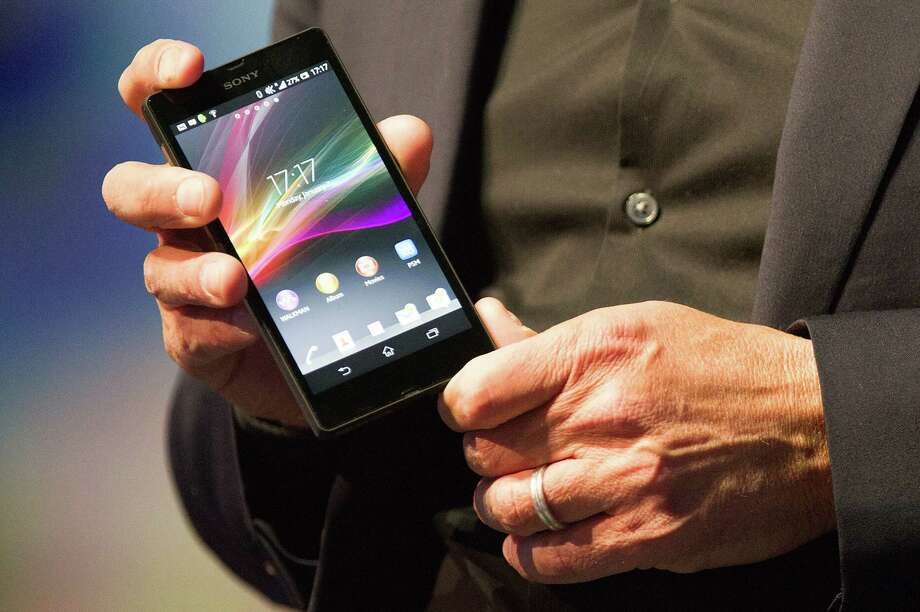 Phil Molyneux, president and chief operating officer of Sony Electronics Inc., holds up a Sony Xperia Z smart phone as he speaks during a news conference at the 2013 Consumer Electronic Show in Las Vegas, Nevada, U.S., on Monday, Jan. 7, 2013. The 2013 CES trade show, which runs until Jan. 11, is the world's largest annual innovation event that offers an array of entrepreneur focused exhibits, events and conference sessions for technology entrepreneurs. Photographer: David Paul Morris/Bloomberg *** Local Caption *** Phil Molyneux Photo: David Paul Morris, Bloomberg / © 2013 Bloomberg Finance LP